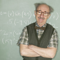 Confident Professor at Blackboard --- Image by © Royalty-Free/Corbis