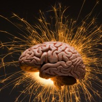 Sparks seem to shoot from a brain, representing thought and intelligence. --- Image by © Louie Psihoyos/Science Faction/Corbis
